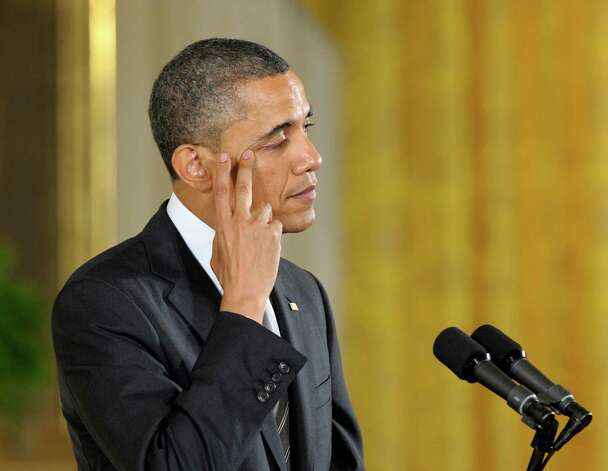 President Barack Obama wipes his eye he talks about the Sandy Hook teachers who were killed during the Newtown, Conn., school shooting, before presenting them posthumously with the 2012 Presidential Citizens Medal, the nationís second-highest civilian honor, Friday, Feb. 15, 2013, during a ceremony in the East Room of the White House in Washington. Photo: Susan Walsh, Associated Press/Susan Walsh / Associated Press