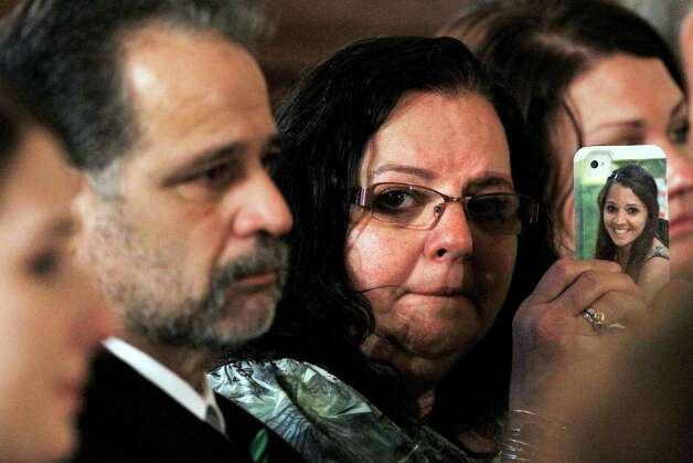 Donna Soto, mother of slain Sandy Hook Elementary School teacher Victoria Soto, holds a cell phone with her daughter's picture on it while attending a ceremony in the East Room of the White House in Washington, Friday, Feb. 15, 2013, where President Barack Obama presented the 2012 Citizens Medal Soto and others. Photo: Jacquelyn Martin, Associated Press/Jacquelyn Marti / AP2013 Associated Press