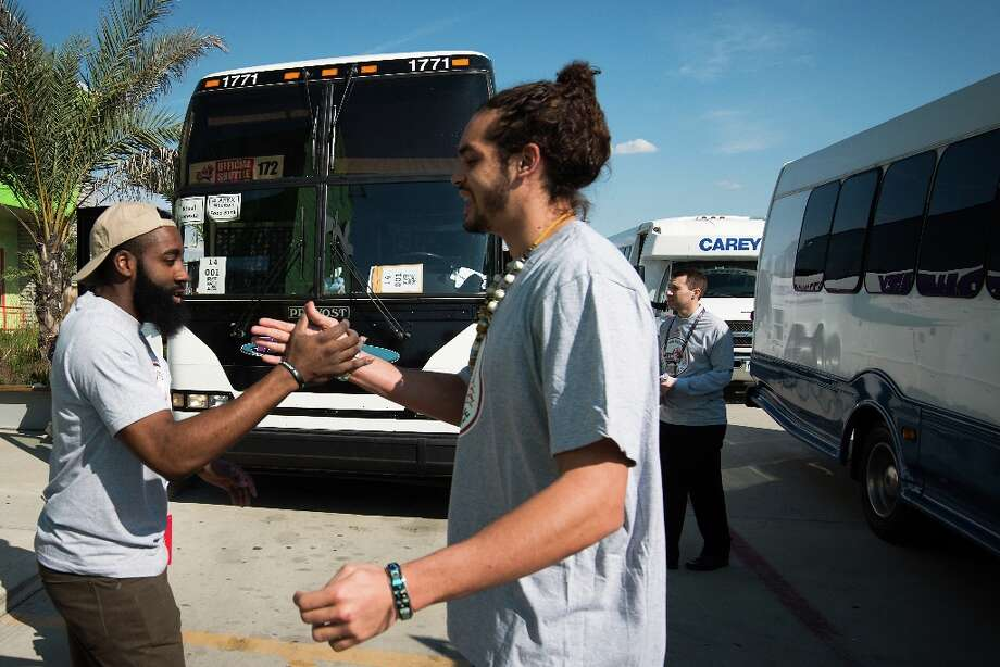 Rockets shooting guard James Harden, left, greets Joakim Noah of the Bulls as they cross paths outside an NBA Cares All-Star Day of Service project at the Houston Food Bank on Friday. Photo: Smiley N. Pool / © 2013  Houston Chronicle