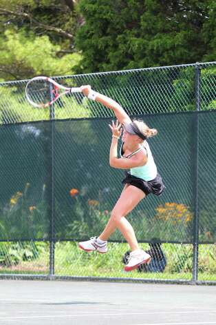 Photo By David Kenas-- Fairfield's Ellyse Hamlin fires a serve during a 2012 match. Photo: Contributed Photo / David Kenas Photography