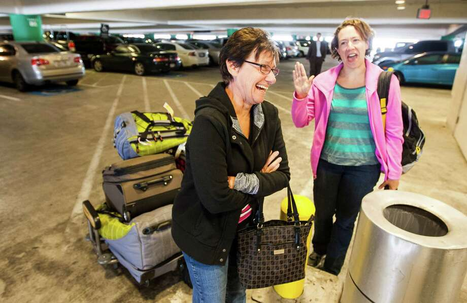Mona Lisee and her daughter Valerie McClintock, both of McKinney, were upbeat about their experience on the Carnival Triumph ship, as they returned to Bush Intercontinental Airport on Friday. Photo: Nick De La Torre, Staff / © 2013 Houston Chronicle