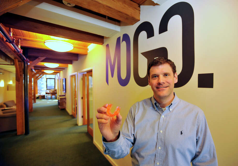 Tom Hoey is the president of MoGo.Sport, LLC in Wilton. MoGo.Sport is a company that manufactures flavored mouthguards. The company currently produces mouthguards with five flavors and will be expanding to eight flavors. Photographed on Thursday, Feb. 14, 2013. Photo: Jason Rearick / The News-Times