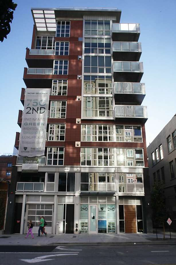The building at 750 Second St. - an eight-story stack of 14 condominiums slipped into a narrow lot across from the Giants' ballpark - is part of a larger tapestry where the main threads already exist. Facing the street, the masonry weaves past large metal windows divided by small panes of glass, modern details with a blue-collar spin. Photo: Lea Suzuki, The Chronicle