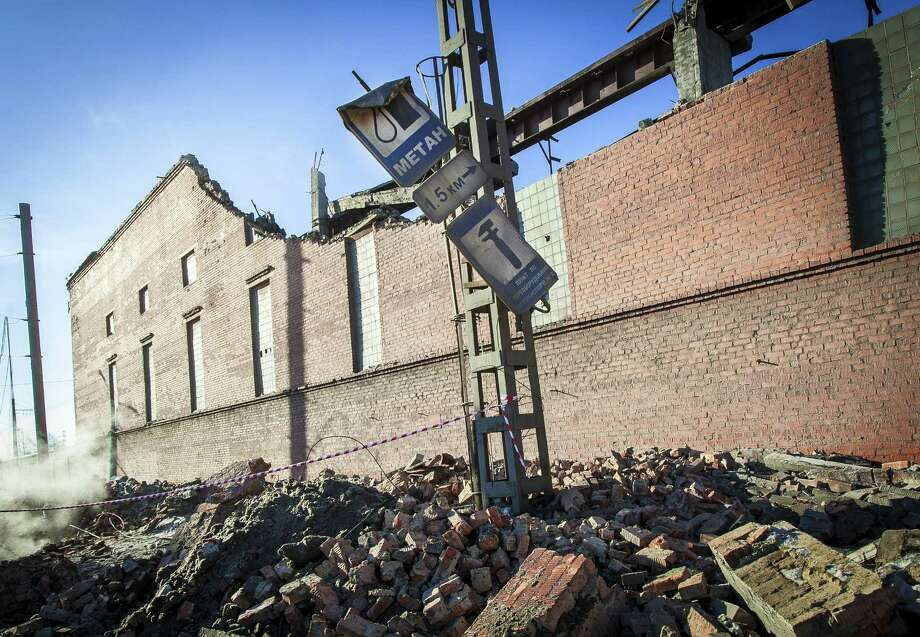 This wall at a zinc plant in Chelyabinsk, Russia, was damaged by the shock wave created by the plunging meteor fragments. Among people injured by the shock wave were 200 children. Photo: Oleg Kargopolov / Getty Images