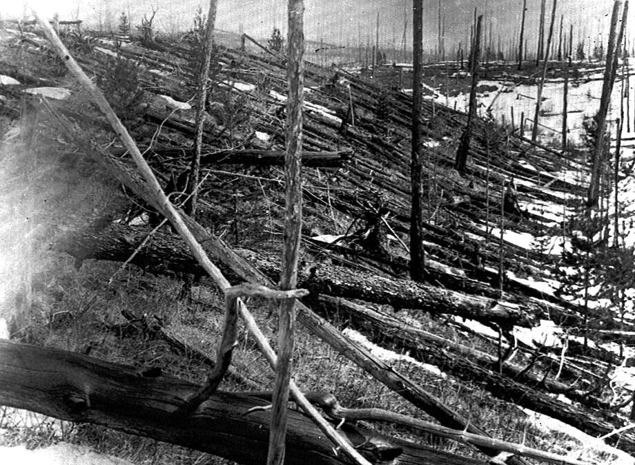 In this 1953 photo, trees lie strewn across the Siberian countryside, 45 years after a meteorite apparently exploded above the Earth near Tunguska, Russia. The explosion leveled some 80 million trees for miles near the site. Photo: Associated Press / AP