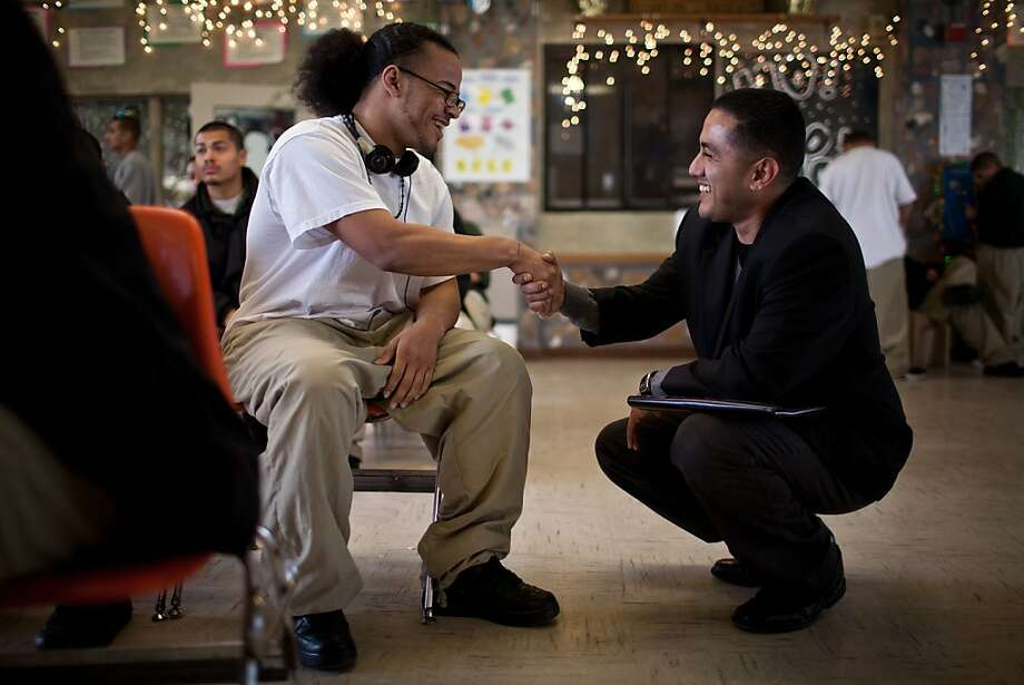 "Francis ""Frankie"" Guzman (right) talks with inmate Chad Scott at the O.H. Close Youth Correctional Facility in Stockton. Guzman, who was sentenced to 15 years at age 15, has become an advocate for juvenile justice. Photo: Max Whittaker/Prime, Special To The Chronicle"