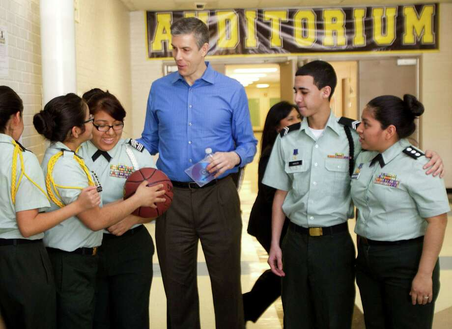 U.S. Secretary of Education Arne Duncan made some new friends during his visit to Lee High School on Friday. Photo: Brett Coomer, Staff / © 2013 Houston Chronicle