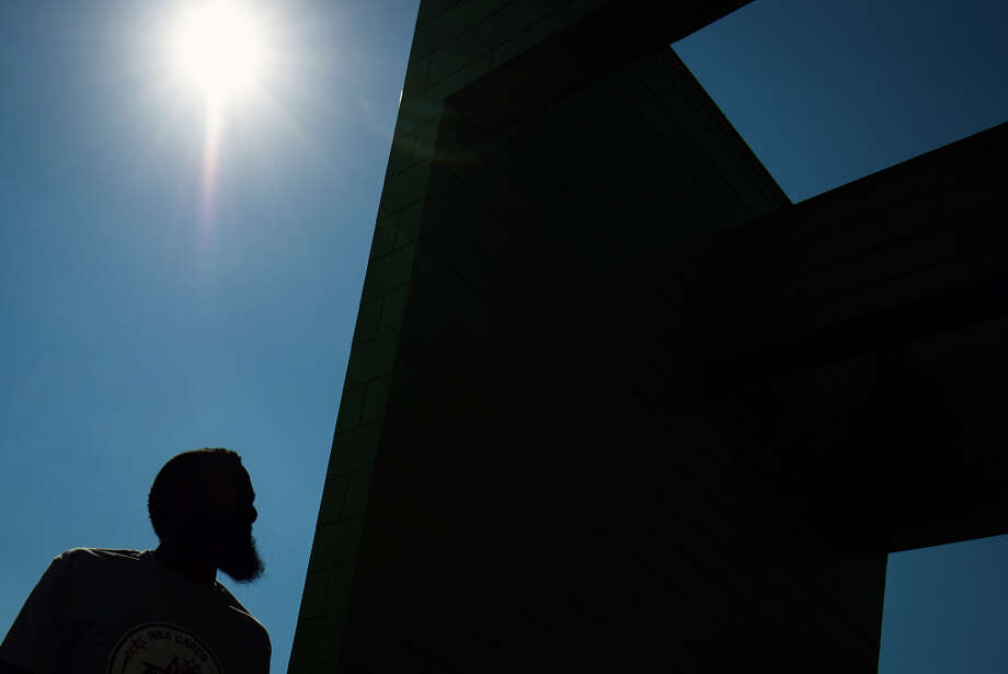 The distinct bearded silhouette of Houston Rockets shooting guard James Harden is seen against a blue sky as he arrives for a NBA Cares All-Star Day of Service project at the Houston Food Bank. Photo: Smiley N. Pool, Houston Chronicle / © 2013  Houston Chronicle
