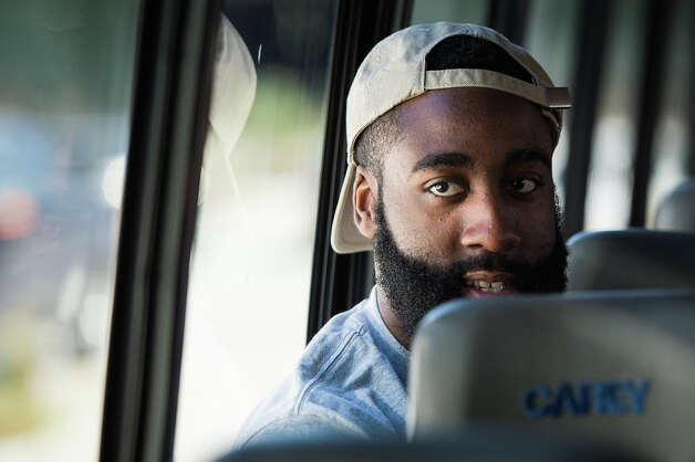 James Harden looks out the window of a bus as he moves between appearances during activities for the NBA All-Star Game. Photo: Smiley N. Pool, Houston Chronicle / © 2013  Houston Chronicle