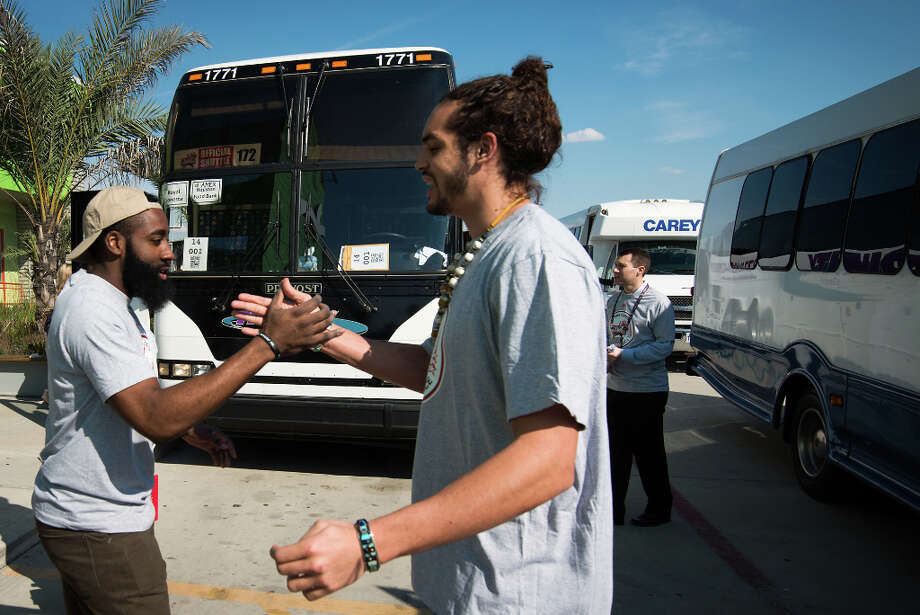 Houston Rockets guard James Harden, left, greets Joakim Noah of the Chicago Bulls as they cross paths outside an NBA Cares All-Star Day of Service project at the Houston Food Bank. Photo: Smiley N. Pool, Houston Chronicle / © 2013  Houston Chronicle