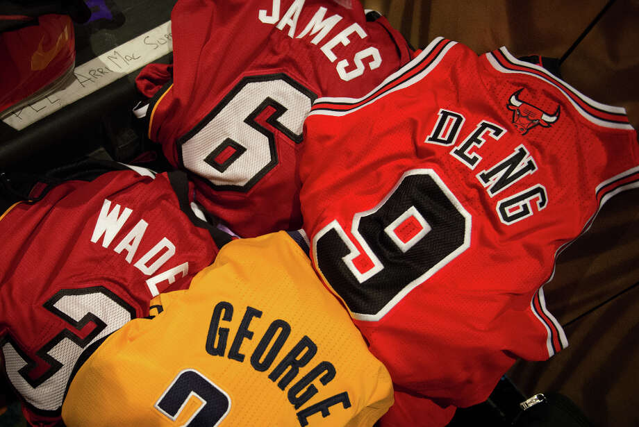 Jereseys for NBA stars LeBron James, Luol Deng, Paul George and Dwyane Wade sit ready for a video shoot during media day. Photo: Smiley N. Pool, Houston Chronicle / © 2013  Houston Chronicle