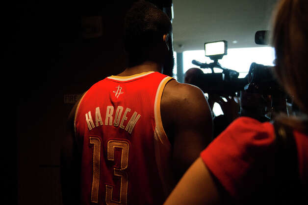 James Harden emerges from one video shoot to face another round of cameras during media day. Photo: Smiley N. Pool, Houston Chronicle / © 2013  Houston Chronicle