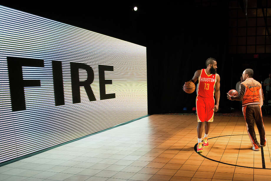 Houston Rockets guard James Harden dribbles a basketball during the shooting of a promotional video with recording artist will.i.am. Photo: Smiley N. Pool, Houston Chronicle / © 2013  Houston Chronicle