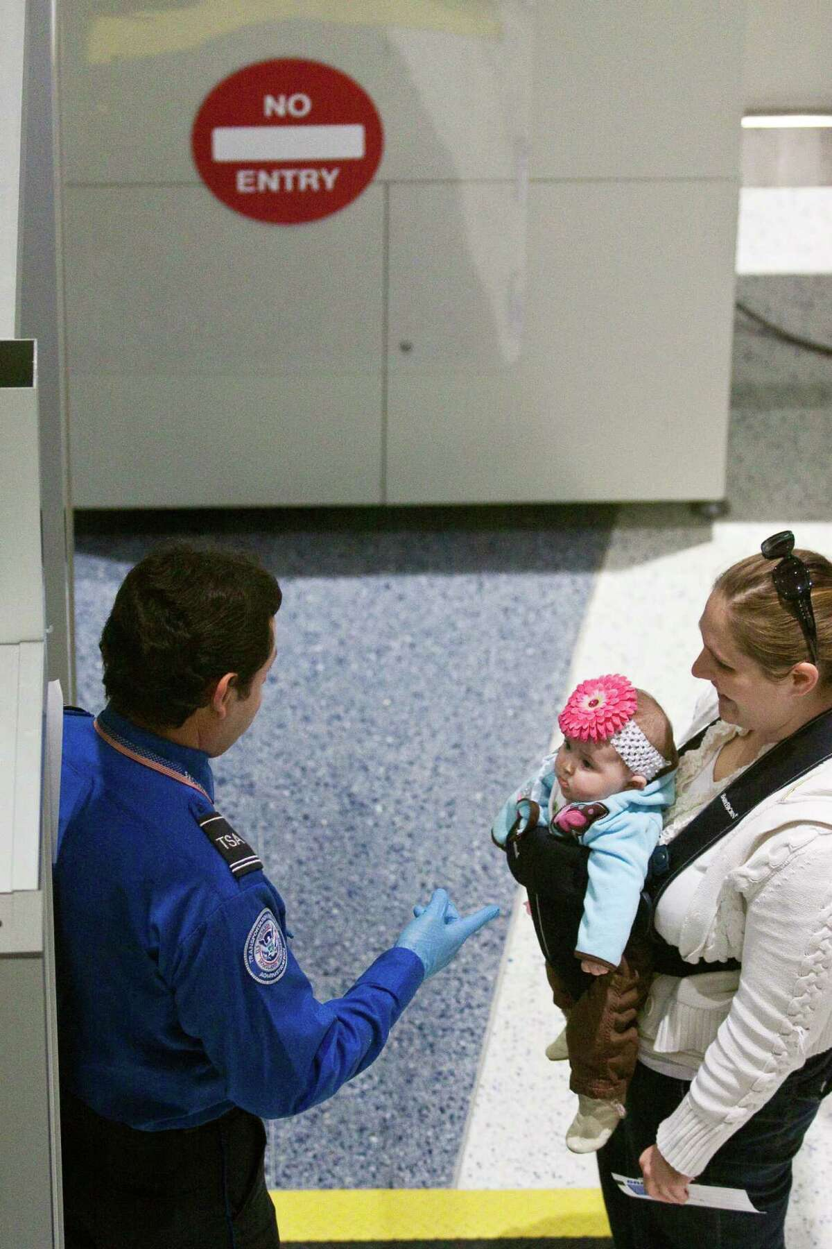 Dec. 27, 2009 - Houston, Texas, USA - A TSA officer points to a baby at a security checkpoint at Bush International Airport following Sheila Jackson Lee's press conference at Bush International Airport regarding the recent attempt at airline terrorism in Detroit, Dec. 27, 2009 in Houston.