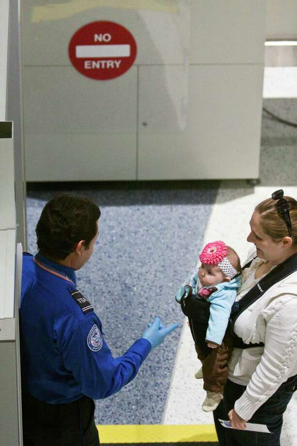 Dec. 27, 2009 - Houston, Texas, USA - A TSA officer points to a baby at a security checkpoint at Bush International Airport following Sheila Jackson Lee's press conference at Bush International Airport regarding the recent attempt at airline terrorism in Detroit, Dec. 27, 2009 in Houston. Photo: Eric Kayne, Freelance / Freelance