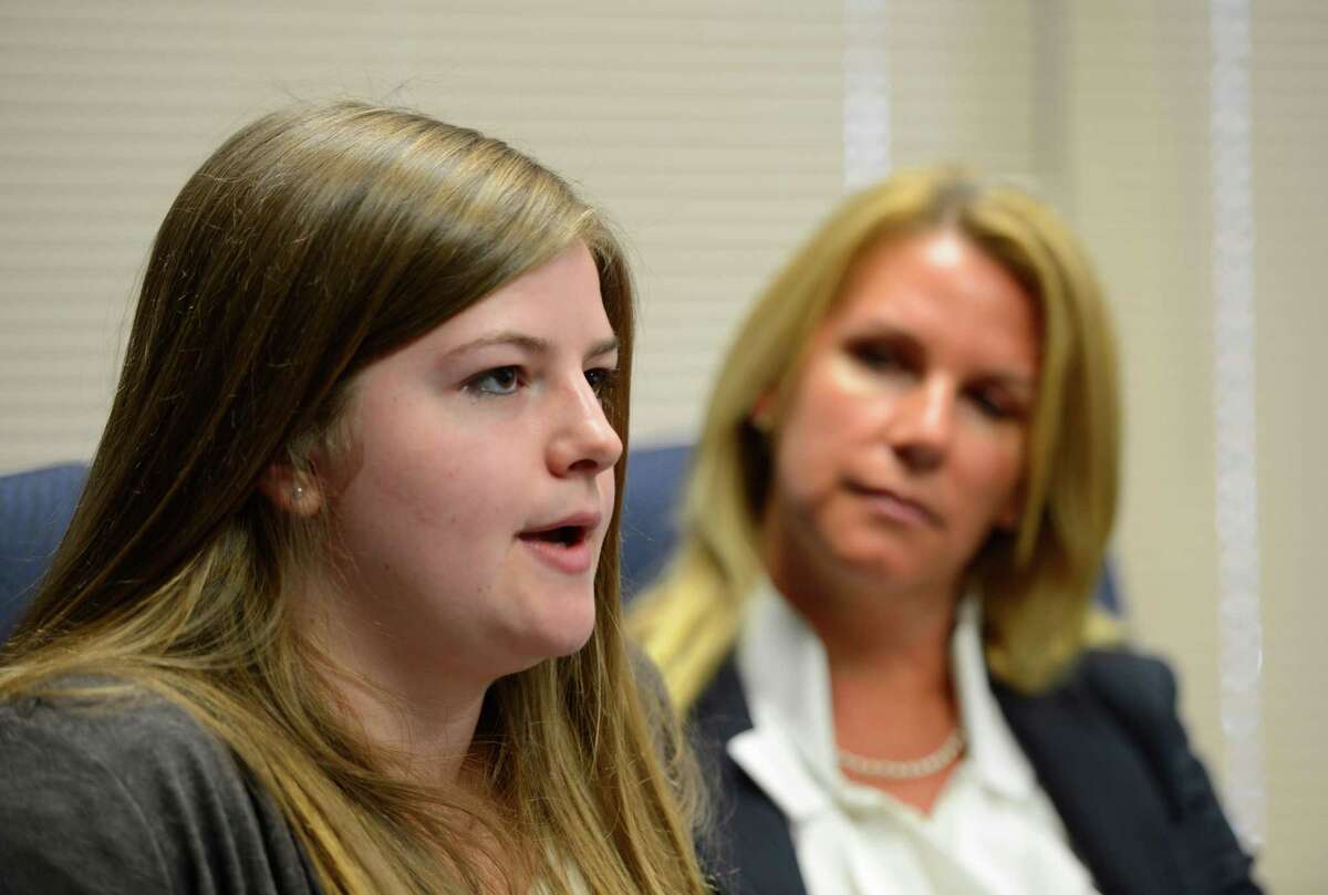 Kate McGuire, left, with attorney Pamela Nichols on Feb. 15, 2013, in Albany, N.Y., tells of her involvement in an accident that was caused by driving while distracted. (Skip Dickstein/Times Union)