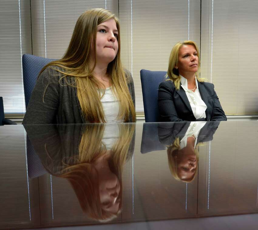 Kate McGuire, left, with attorney Pamela Nichols ono Feb. 15, 2013, in Albany, N.Y., tells of her involvement in an accident that was caused by driving while distracted. (Skip Dickstein/Times Union)