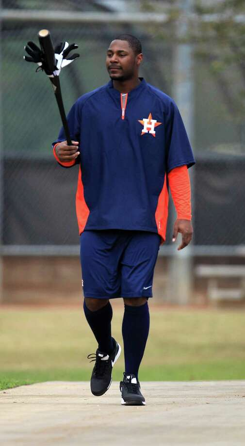 With a sudden surplus of first basemen on the roster, the newly acquired Chris Carter could shift to the outfield on a regular basis this season. Photo: Karen Warren, Staff / © 2013 Houston Chronicle