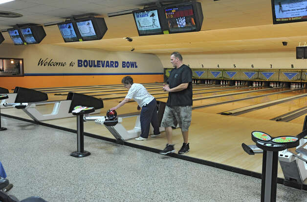 Alice Buell of Schenectady gets bowling tips from Blaise Lawyer of Boulevard Bowl at the bowling alley in Schenectady, N.Y. Tuesday, Sept. 27, 2011. (Lori Van Buren / Times Union) Photo: Lori Van Buren / 00014781A