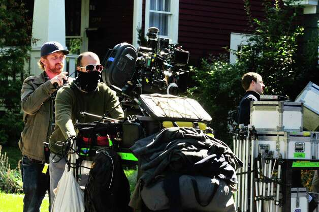 "The camera is moved during filming of a scene from ""The Place Beyond the Pine"" at a private home on Story Avenue in Niskayuna ,NY Friday Sept.16, 2011. ( Michael P. Farrell/Times Union) Photo: Michael P. Farrell / 00014660A"