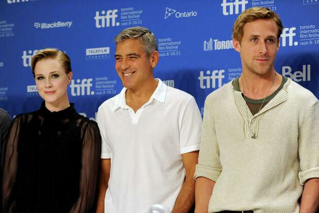 "From left, actors Evan Rachel Wood, George Clooney and Ryan Gosling participate in a press conference for the film ""The Ides of March"" during the Toronto International Film Festival on Friday, Sept. 9, 2011 in Toronto. (AP Photo/Evan Agostini) Photo: Evan Agostini / AGOEV"