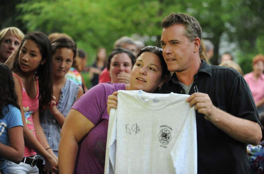 """Actor Ray Liotta takes a break from filming on set of the movie """"The Place Beyond the Pines"""" to greet some eager fans waiting on Story Ave. in Niskayuna, N.Y. on Wednesday, Aug. 31, 2011.  Here Christine Helstowski gets her photo taken with the actor after having him sign a Schenectady Fire Department shirt.  (Lori Van Buren / Times Union) Photo: Lori Van Buren"""