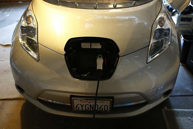Pannan Barry keeps his Nissan Leaf plugged in every night but only uses about half the battery during the day during his commute from San Francisco to Richmond. The electric car is still foreign to many but is striving to take the popularity away from traditional cars. Photo: James Tensuan, The Chronicle