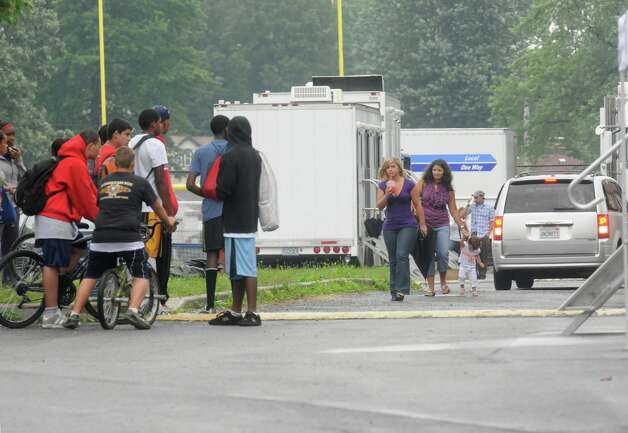 "Students gather in the parking lot as the movie ""Place Beyond the Pines""  was being filmed at Schenectady High School in Schenectady ,NY Wednesday Aug. 24,2011.( Michael P. Farrell/Times Union) Photo: Michael P. Farrell / 00014413A"