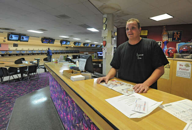 Blaise Lawyer of Boulevard Bowl stands at the front desk of the bowling alley in Schenectady, N.Y. Tuesday, Sept. 27, 2011. (Lori Van Buren / Times Union) Photo: Lori Van Buren / 00014781A