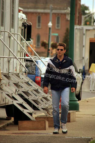"Actor, Bradley Cooper, is pictured entering the Schenectady Police Dept. during filming for ""A Place Beyond the Pines,"" Tuesday Aug. 23, 2011. (Courtesy www.FredrickCheesecake.com)"
