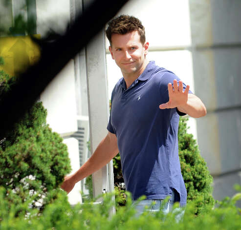 Bradley Cooper waves to his fans as he enters City Hall for the day's filming of ?The Place Beyone the Pines? on Friday, Aug. 12, 2011, in Schenectady, N.Y. (Cindy Schultz / Times Union) Photo: Cindy Schultz / 00014195D