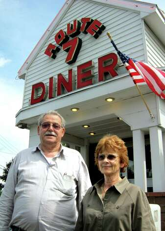"Diner owner Peter Kounoupis, left, and manager Colleen Noble talk about filming of ""Place Beyond the Pines"" on Tuesday, Aug. 16, 2011, at Route 7 Diner in Latham,, N.Y. Eva Mendes, Ryan Gosling and Bradley Cooper were at the diner for three days of shooting. (Paul Grondahl / Times Union) Photo: Cindy Schultz / 00014283A"