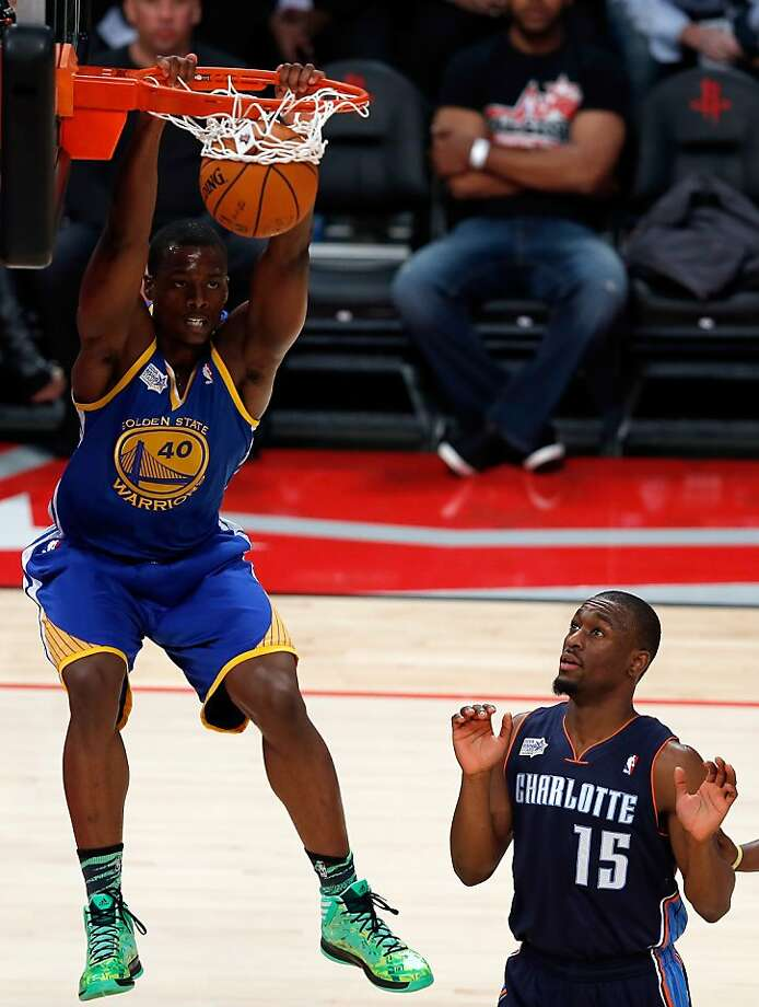 Warriors' Harrison Barnes dunks as Charlotte's Kemba Walker takes a hands-off approach. Photo: Scott Halleran, Getty Images