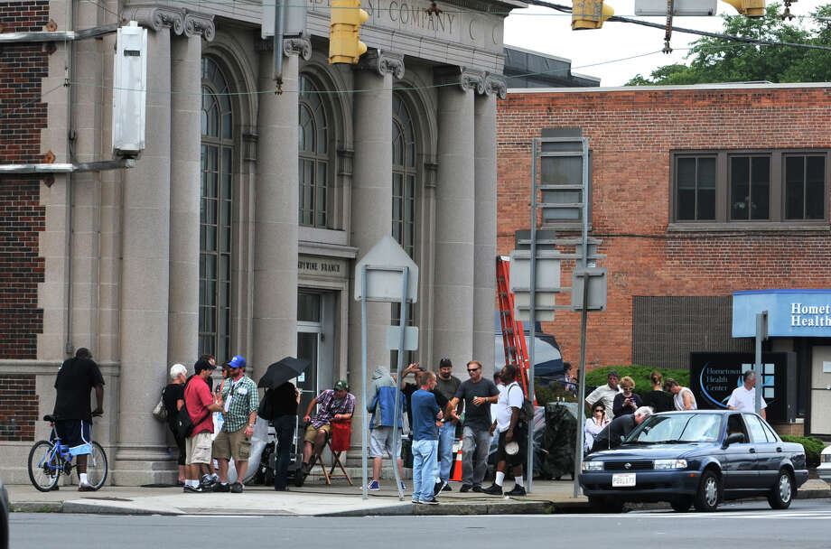 Movie crew wait outside a bank on State Street as they film the movie The Place Beyond the Pines in Schenectady, N.Y. on Monday, Aug. 8, 2011.  (Lori Van Buren / Times Union) Photo: Lori Van Buren / 00014178A
