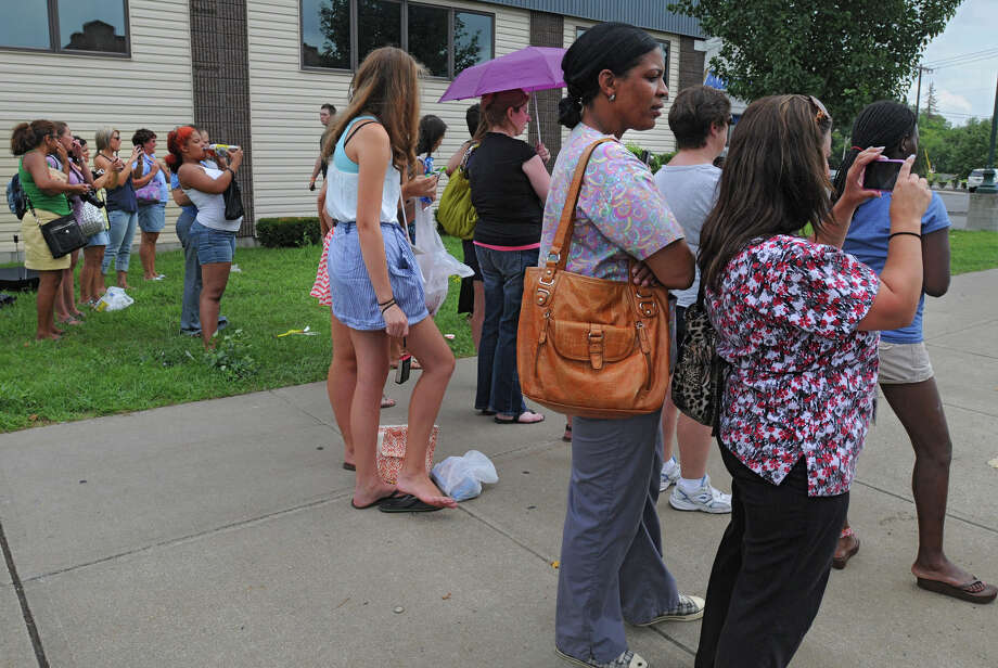 Onlookers wait for a scene to be filmed when State Street from McClellan Street through Swan Street was closed due to filming for the movie The Place Beyond the Pines in Schenectady, N.Y. on Monday, Aug. 8, 2011.  (Lori Van Buren / Times Union) Photo: Lori Van Buren / 00014178A
