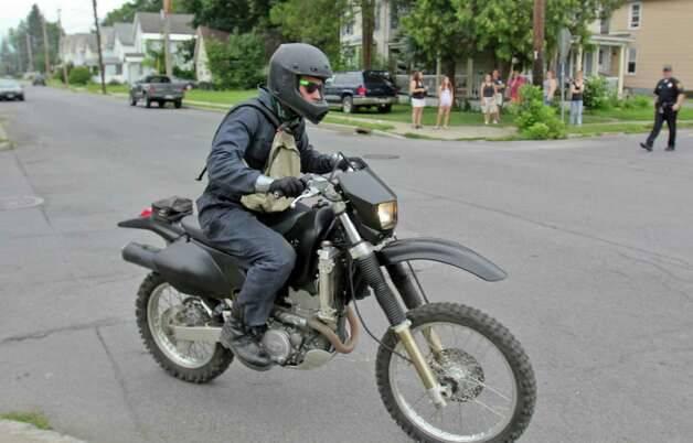 "A helmet clad motorcycle rider is captured during filming for ""The Place Beyond the Pines,"" Scotia N.Y., Friday morning, July 29, 2011. Actor, Ryan Gosling, was seen wearing the same outfit during Friday's shooting. (Erin Colligan / Special to the Times Union)"