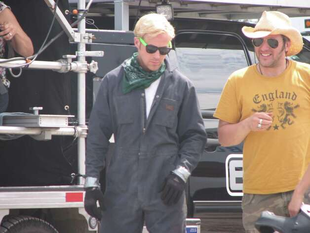 "Ryan Gosling during a break in the filming of ""The Place Beyond the Pines"" on Route 5 in Glenville. Gosling was riding a motorcycle for a scene in the film. (Desiree LaBombard / Special to the Times Union)"
