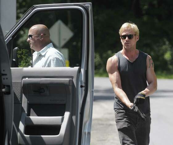 "Actor  Ryan Gosling, right, gets into a van at parking lot that is part of the Stanford Heights Fire Department in Schenectady on Wednesday, July 27, 2011.  The parking lot was being used by the crew of the movie ""The Place Beyond the Pines""  to work out of while filming was being done nearby.   (Paul Buckowski / Times Union) Photo: Paul Buckowski"