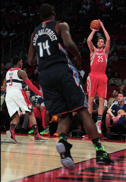 Chandler Parsons of the Rockets shoots a three-pointer.