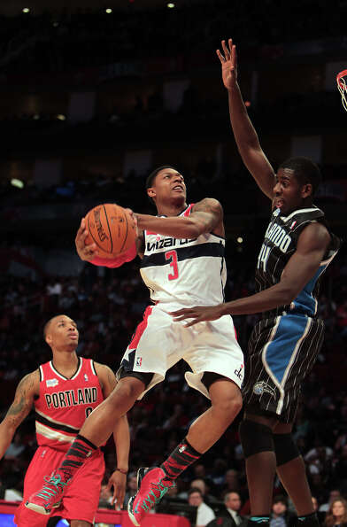 Bradley Beal of the Wizards goes to the basket as Andrew Nicholson of the Magic defends.
