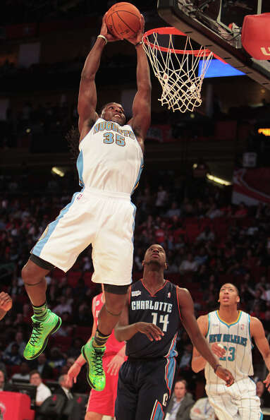 Kenneth Faried of the Nuggets goes up for a dunk.