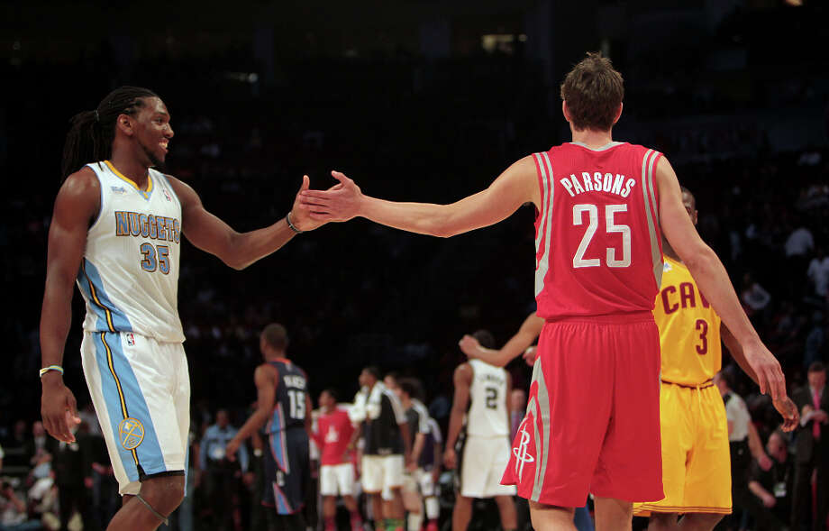 Chandler Parsons of the Rockets gets a high five from Kenneth Faried of the Nuggets. Photo: James Nielsen, Chronicle / © Houston Chronicle 2013