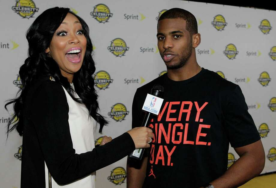 Singer Monica interviews Los Angeles Clippers star Chris Paul on Friday night at the All-Star Celebrity Game at the George R. Brown Convention Center. Photo: Melissa Phillip, Staff / © 2013 Houston Chronicle