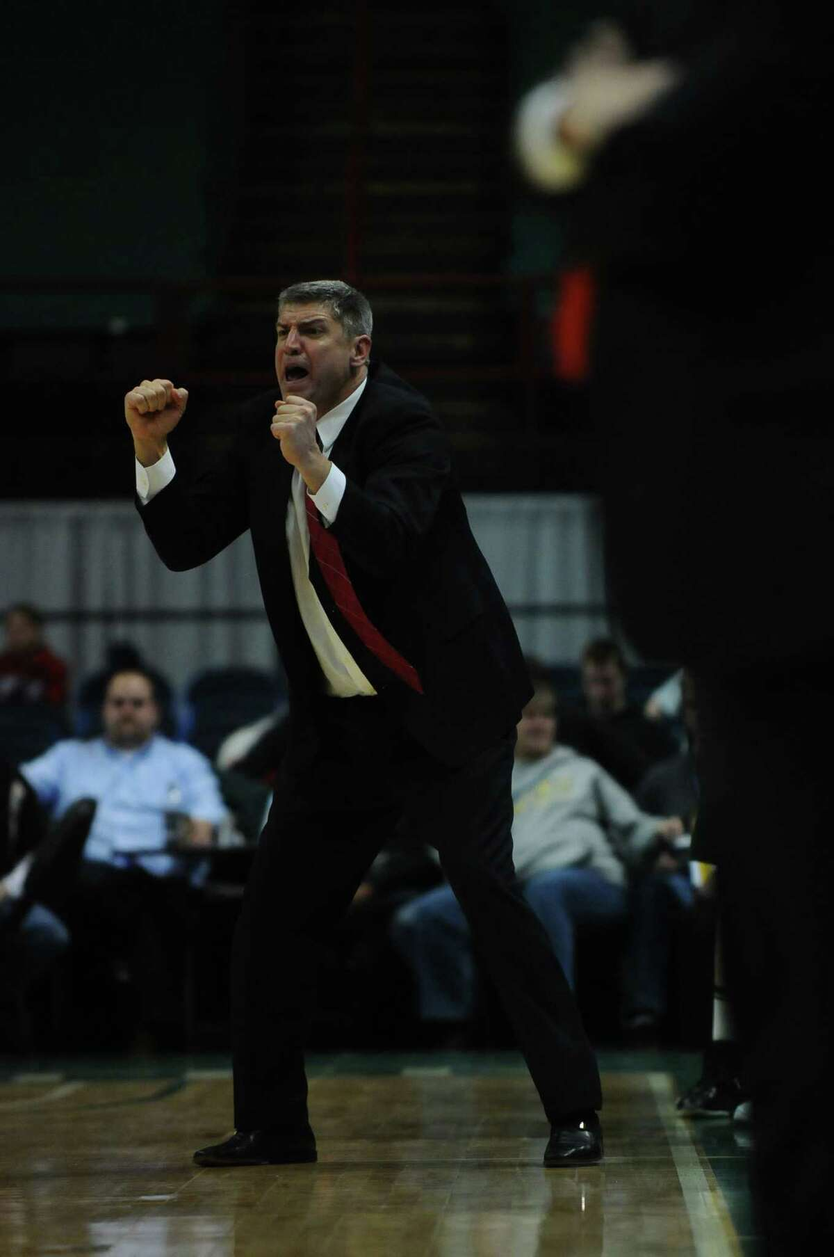 Loyola head coach Jimmy Patsos cheers on his team during the second half of Siena's 76-69 loss to Loyola at the Times Union Center in Albany, NY on Monday February 7, 2011. ( Philip Kamrass / Times Union )