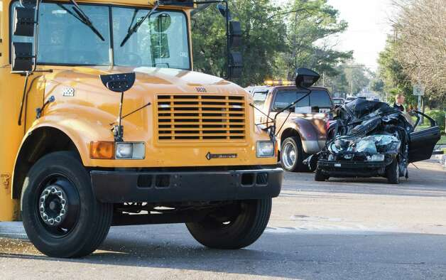 An HISD bus and a Honda Accord collided Friday morning at 7500 Beechnut, near Braeburn Valley. Photo: Nick De La Torre, Staff / © 2013 Houston Chronicle