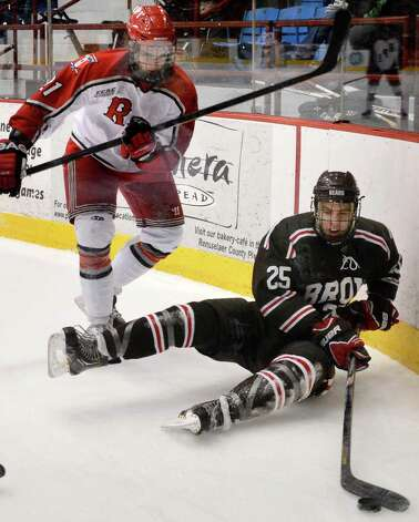 RPI's #21 Mark McGowan, left, and Brown's #25 Brandon Pfeil during Friday night's game at the Houston Field House in Troy  Feb. 15, 2013.  (John Carl D'Annibale / Times Union) Photo: John Carl D'Annibale / 00021137A