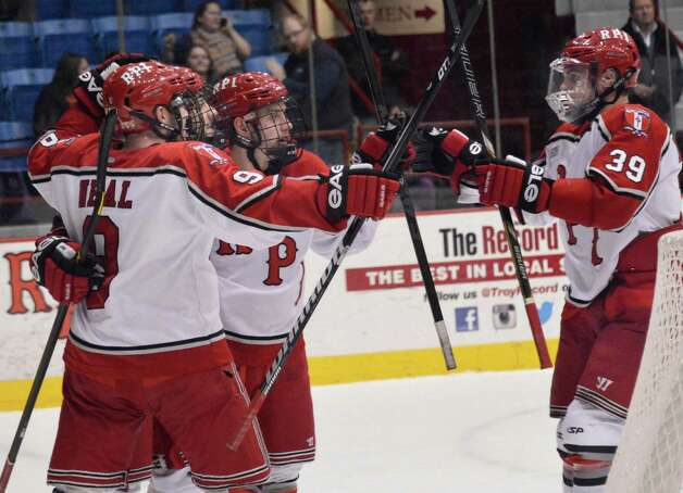 RPI players celebrate a goal by Nick Bailen during Friday night's game against Brown at the Houston Field House in Troy  Feb. 15, 2013.  (John Carl D'Annibale / Times Union) Photo: John Carl D'Annibale / 00021137A