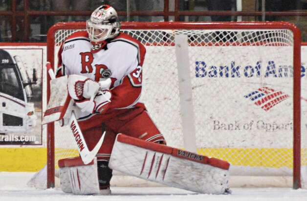 RPI goalie Jason Kasdorf traps a shot against his chest during Friday night's game against Brown at the Houston Field House in Troy  Feb. 15, 2013.  (John Carl D'Annibale / Times Union) Photo: John Carl D'Annibale / 00021137A