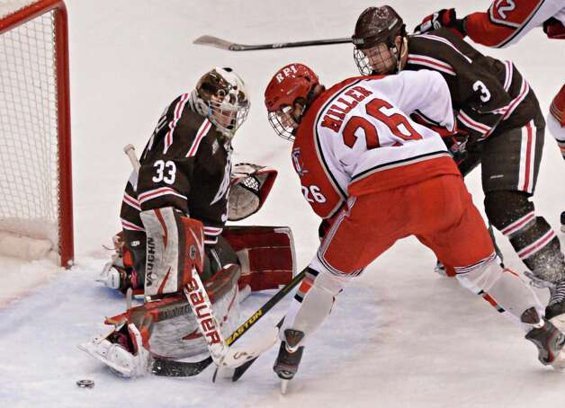 RPI's # 26 Mark Miller is blocked by Brown goalie Anthony Borelli during Friday night's game at the Houston Field House in Troy  Feb. 15, 2013.  (John Carl D'Annibale / Times Union) Photo: John Carl D'Annibale / 00021137A