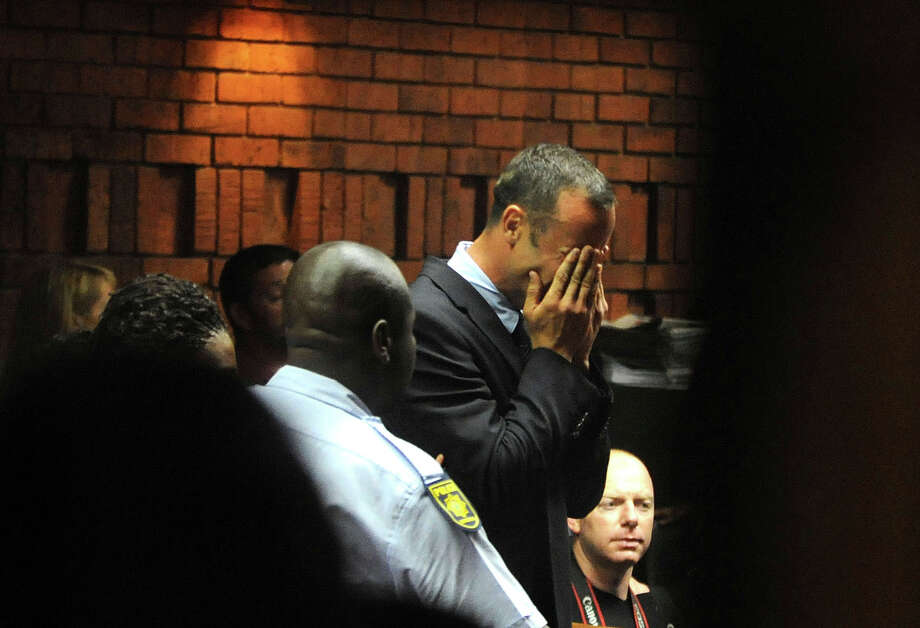 Athlete Oscar Pistorius weeps in court in Pretoria, South Africa, Friday, Feb 15, 2013, at his bail hearing in the murder case of his girlfriend Reeva Steenkamp.   Oscar Pistorius arrived at a courthouse Friday, for his bail hearing in the murder case of his girlfriend as South Africans braced themselves for the latest development in a story that has stunned the country. The Paralympic superstar was earlier seen leaving a police station in a dark suit with a charcoal gray jacket covering his head as he got into a police vehicle. Model Reeva Steenkamp was shot and killed at Pistorius' upmarket home in an eastern suburb of the South African capital in the predawn hours of Thursday. (AP Photo/Antione de Ras - Independent Newspapers Ltd South Africa) SOUTH AFRICA OUT Photo: Antoine De Ras